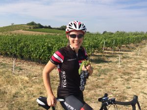 Cyclist eating grapes in Provence